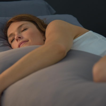 woman sleeping on gray wicked sheets body pillowcase