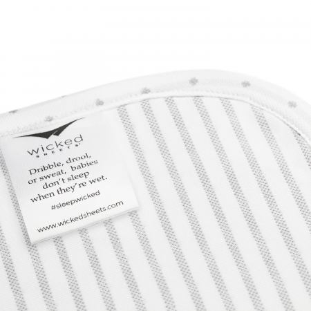 wicked sheets tag that reads dribbles, drool, or sweat, babies don't sleep when they're wet