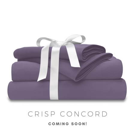 crisp concord set of wicked sheets stacked and tied with a white bow