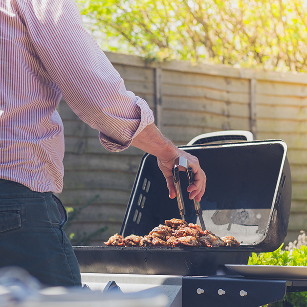 man grilling on barbeque grill outside at wicked sheets