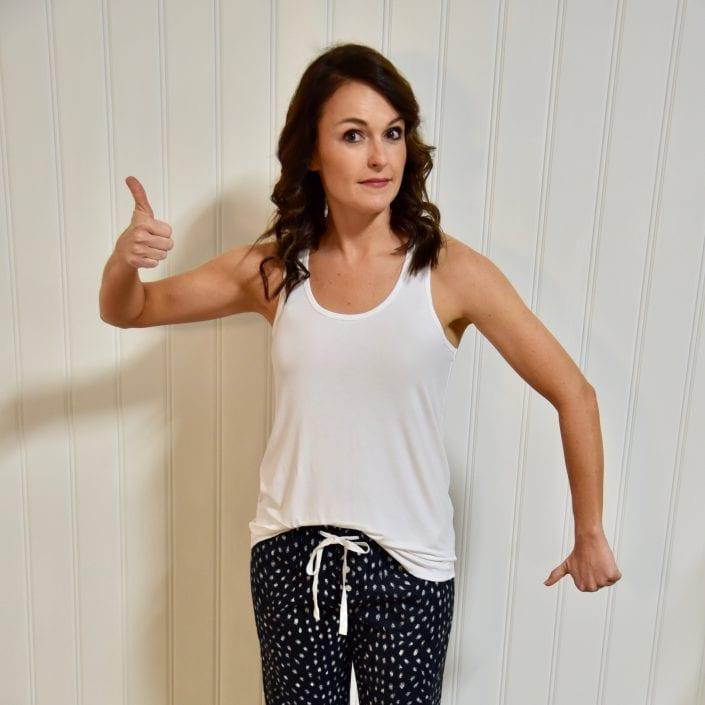 woman in white pajama top black pajama bottom
