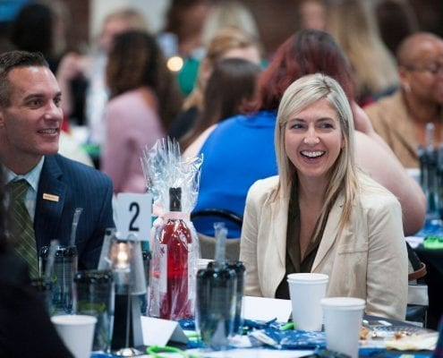 CEO Alli Truttmann laughing with guests at Pearls of Wisdom event at wicked sheets