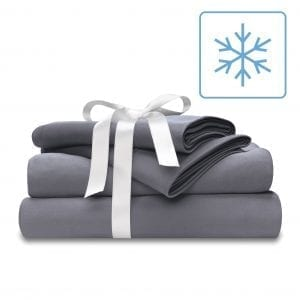 cooling bed sheet set in cool gray wrapped in a white bow