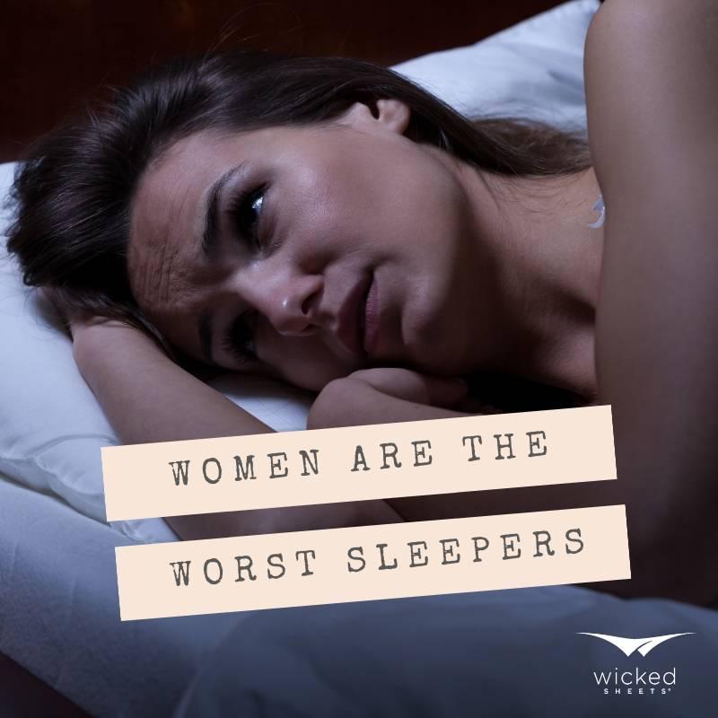 women sleep worse, image of woman awake in bed