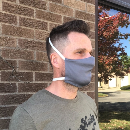 man wearing a gray wicked sheets breathable face mask with thick elastic