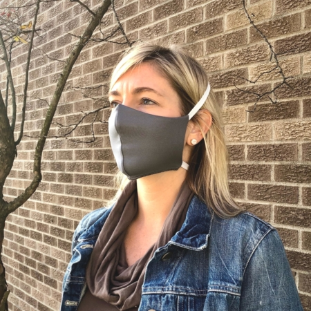 woman wearing a gray wicked sheets breathable face mask with thick elastic
