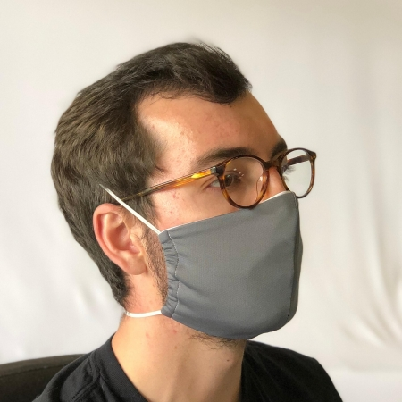 young man with glasses wearing a face mask