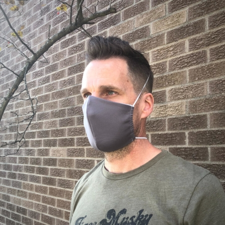 man wearing a gray wicked sheets breathable face mask with thin elastic