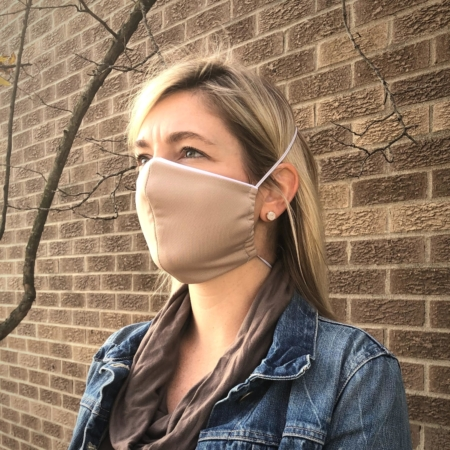 woman wearing a beige wicked sheets breathable face mask with thin elastic