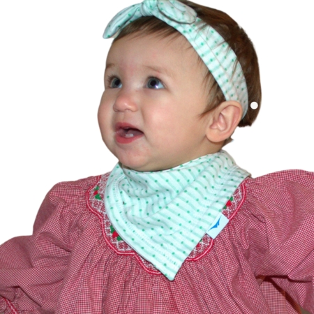 toddler in red dress wearing a wicked sheet green polka dot bandana and headband