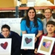 bluegrass center for autism students hold up their heartwork